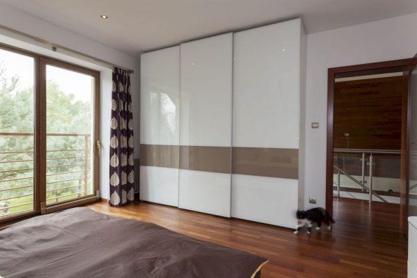 Contemporary bedroom with balcony and huge wardrobe